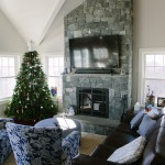 beautiful, warm open living room with custom stone fireplace