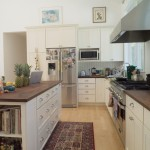 Net Zero white kitchen with butcher block counter