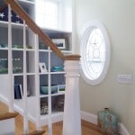 coastal staircase with oval window